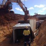 excavators installing box culverts
