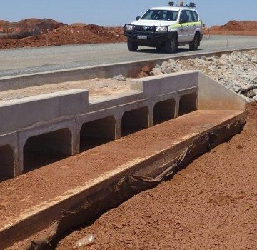vehicle running on road and box culverts head walls is used to pass water flow