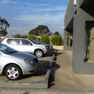 Cars park at parking station