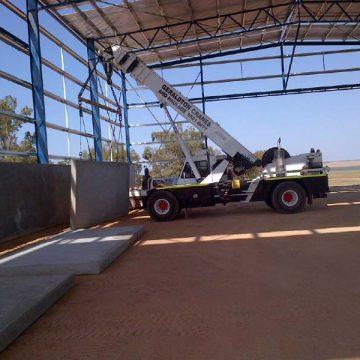 crane installing concrete tilt wall panels