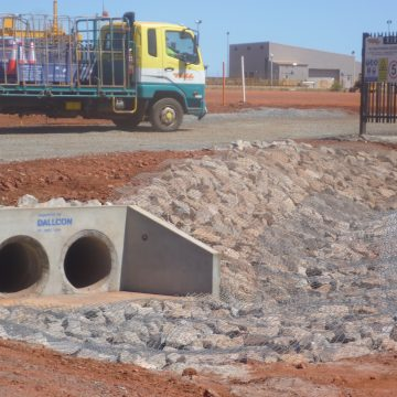 installed concrete pipe headwalls on side of road