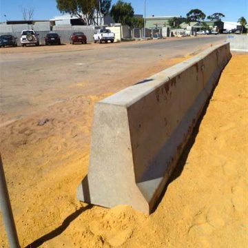 installed concrete traffic barrier at road