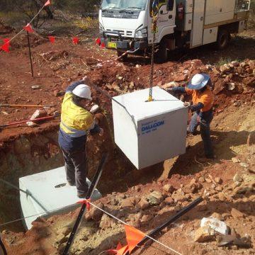 workers installing concrete tie down blocks