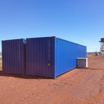 cyclonic tie down block to tie two blue containers