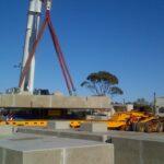 mobile crane lifting concrete footing