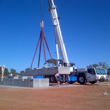 mobile crane lifting concrete footing