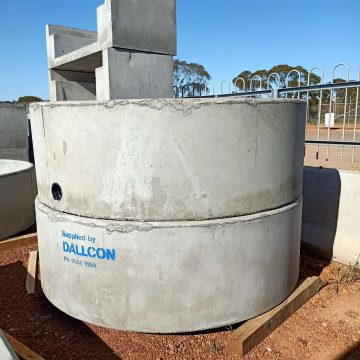 Two concrete round cattle water trough in a pile