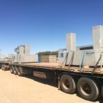 truck carrying concrete footings