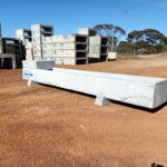 side view of concrete combo water trough