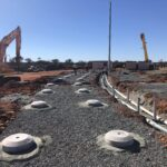 concrete irrigation donuts on site