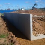 installation of concrete retaining wall on construction site