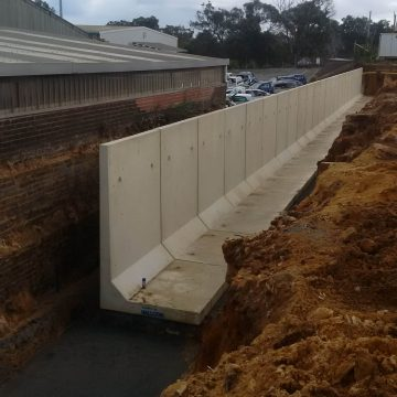 installing retaining wall to separate boundary